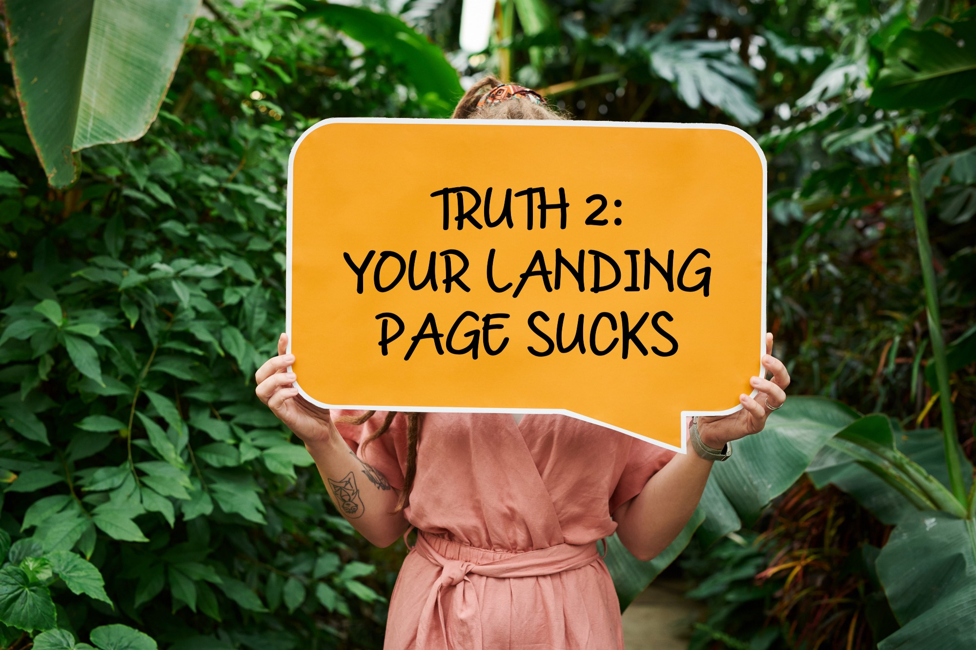 "Woman holds up ""your landing page sucks"" sign."