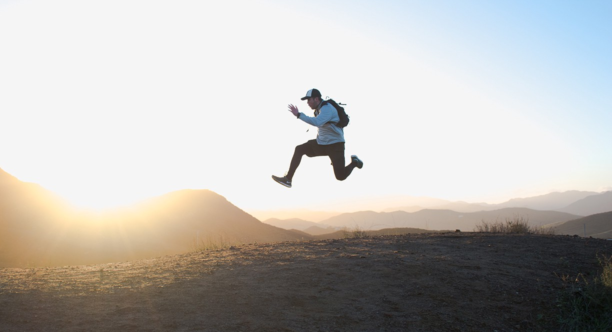 Man jumping in the air in the mountains