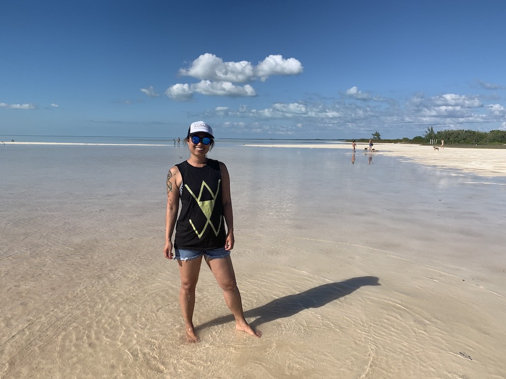 Natalie Khoo standing on the beach at Isla Blanca, Mexico