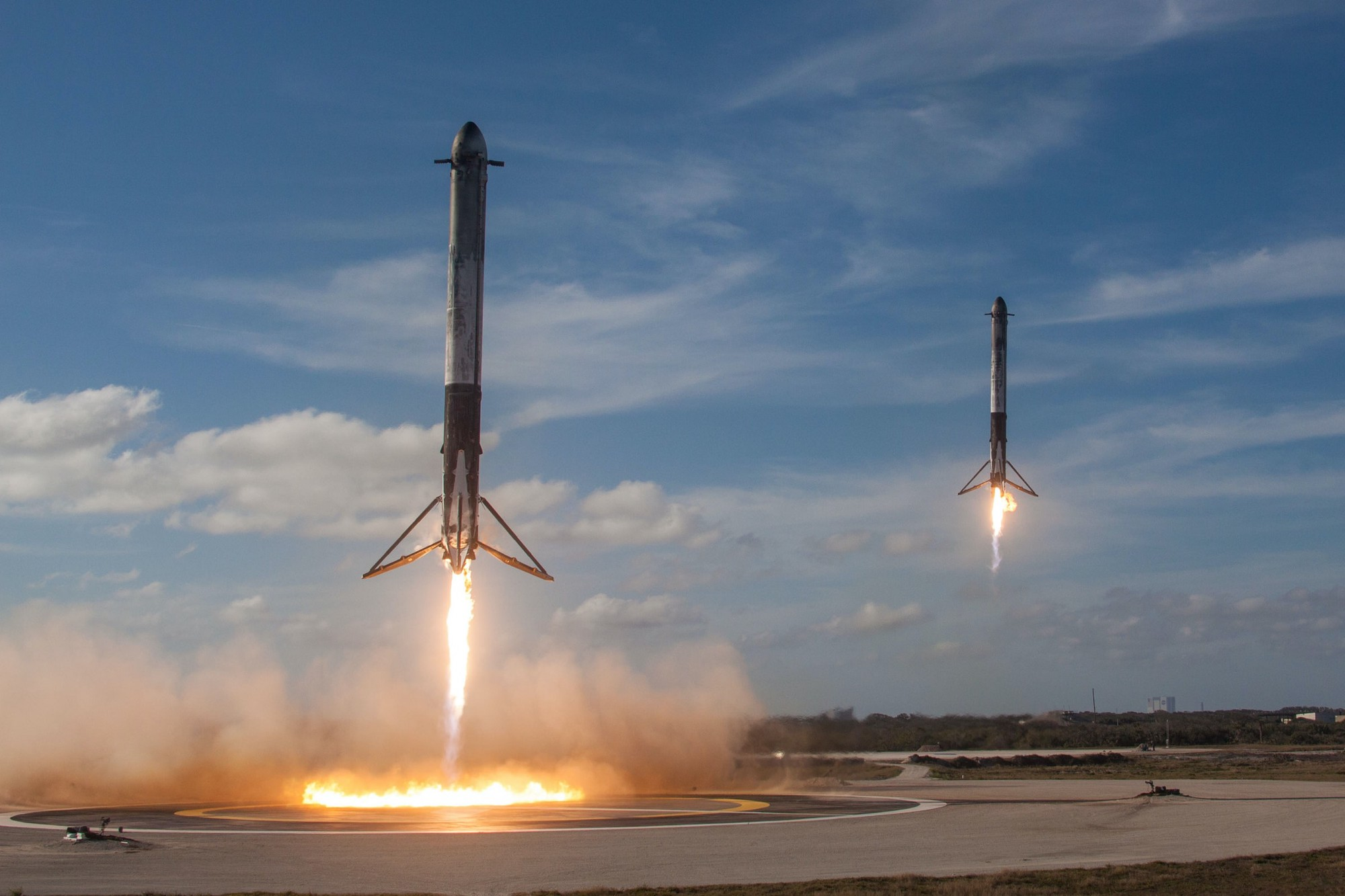 Two SpaceX Falcon Heavy Booster rockets landing simultaneously