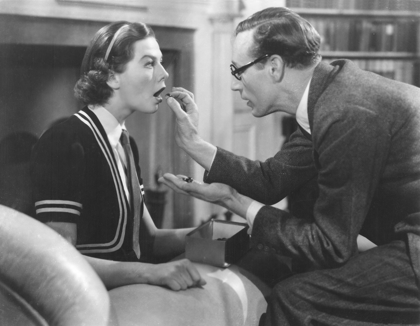 A scene from the play in which Henry Higgins attempts to improve Eliza's accent by making her speak with marbles over her tongue. A tried and tested technique used to treat speech impairments such as stuttering.