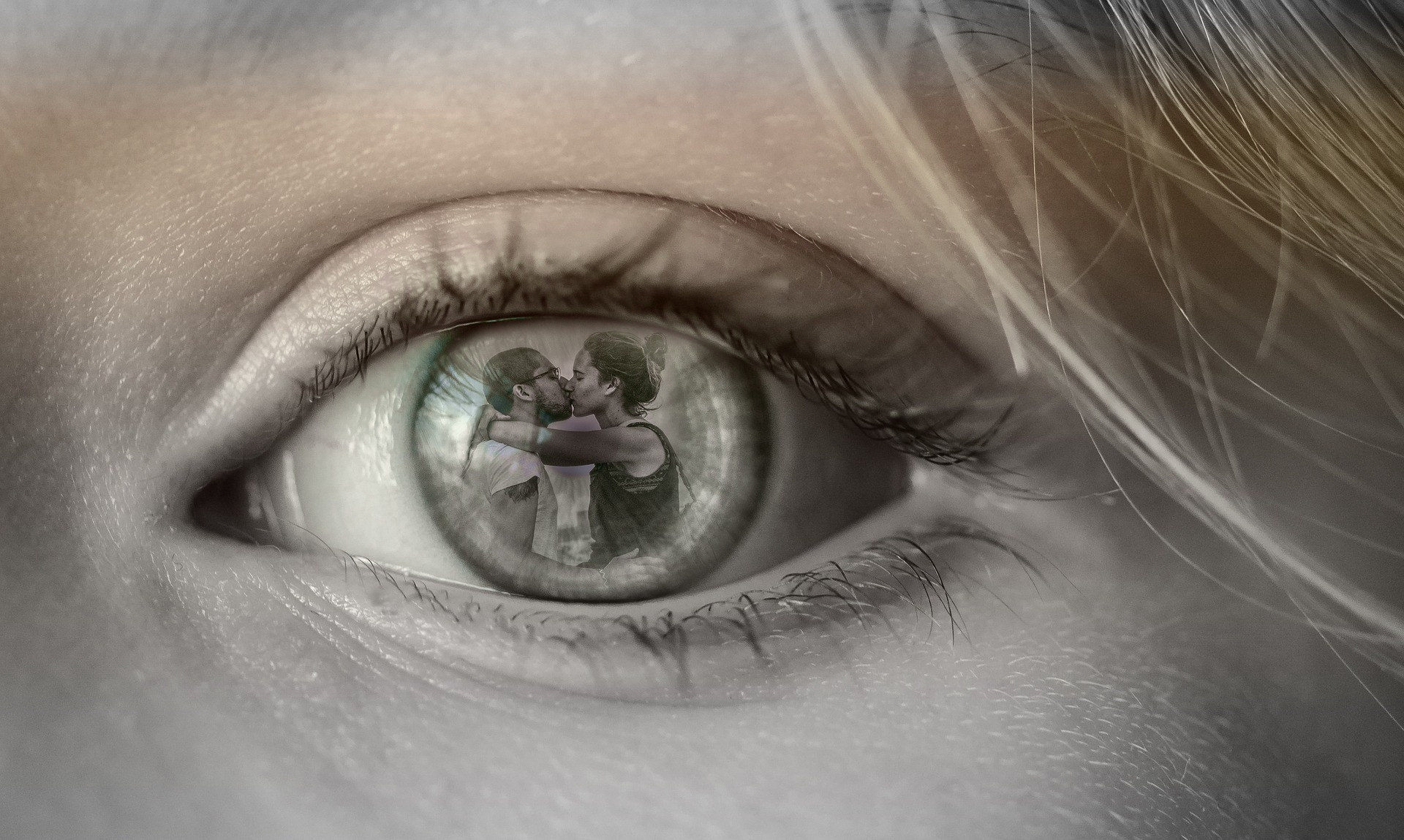 Close Up of Woman's eye with lovers reflection as the pupil