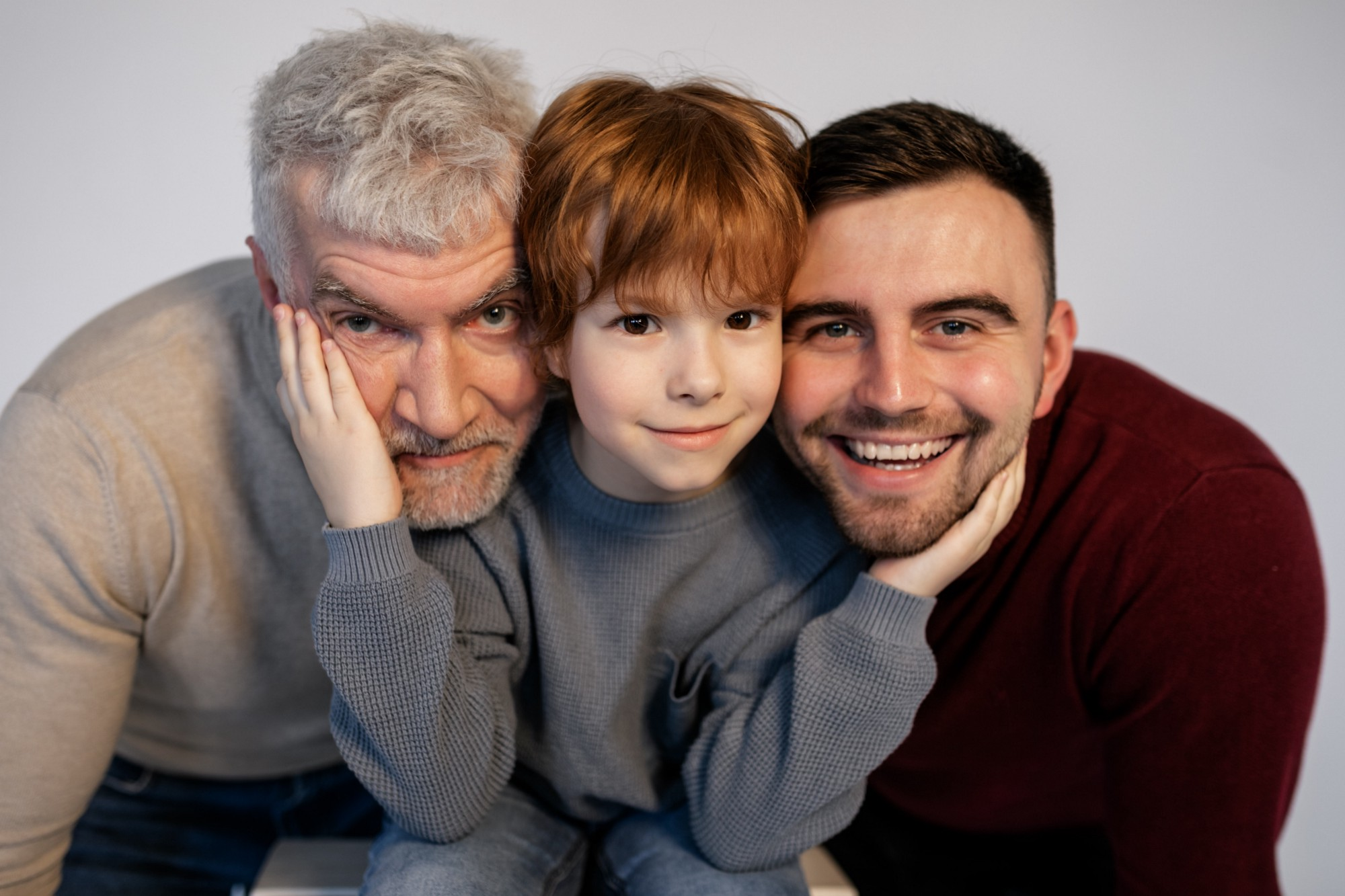 a child with his father and grandfather