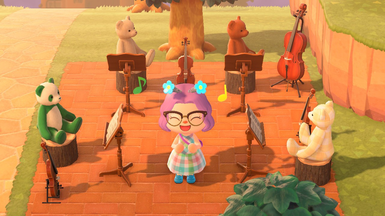The author's animal crossing character posing in front of a teddy bear string quartet decoration.