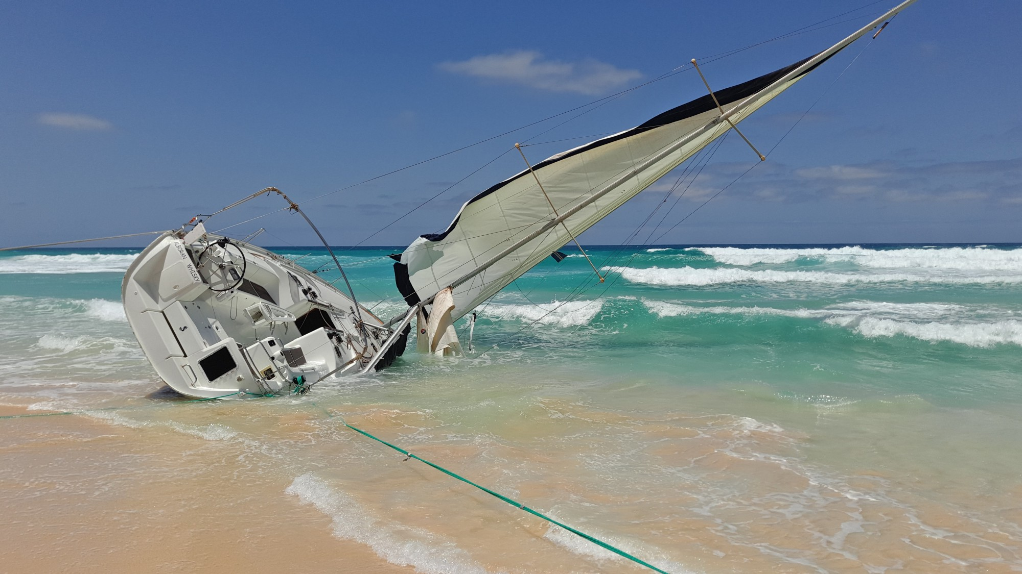 Image of sailboat stuck on sand