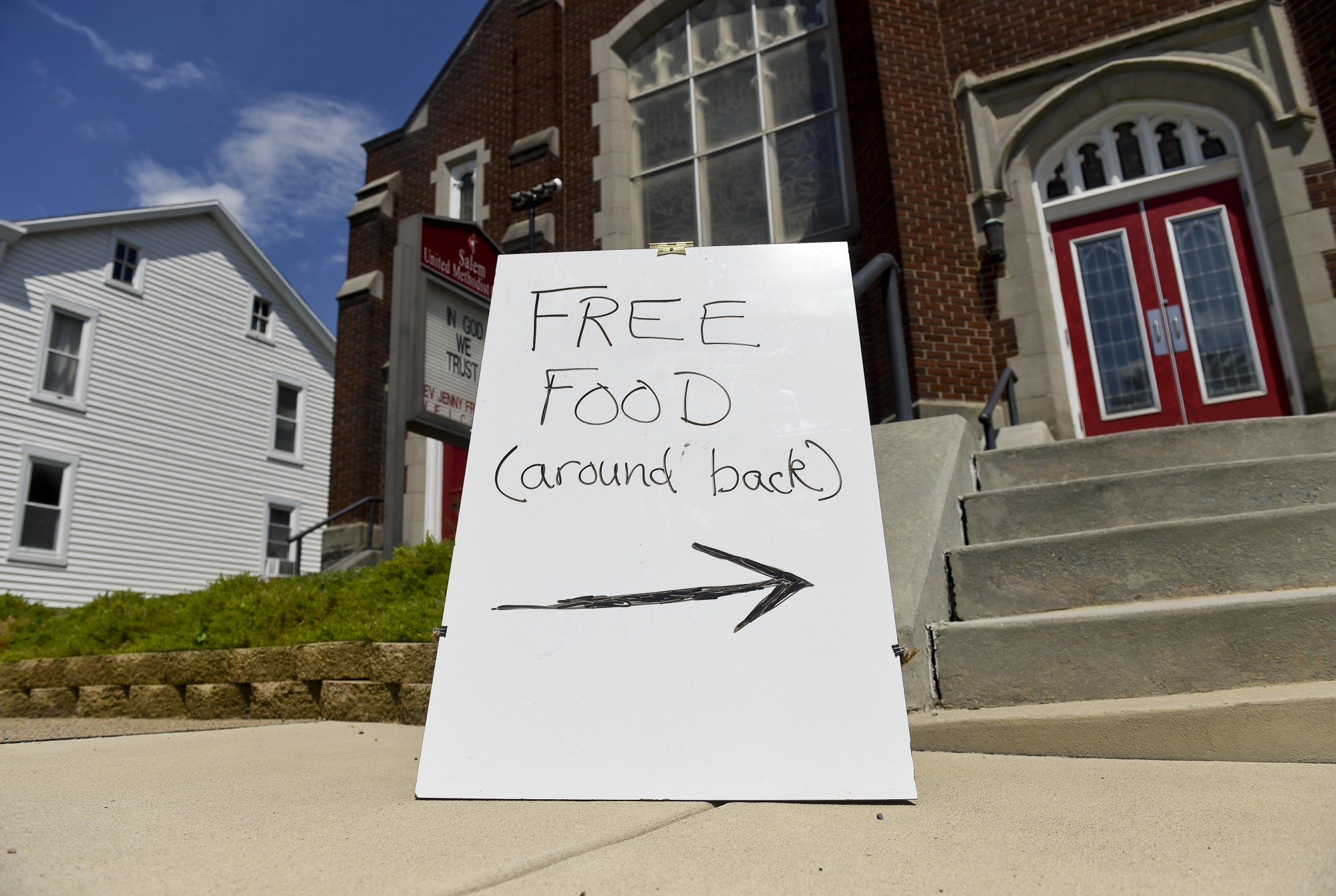 """A """"free food"""" sign in front of a church."""