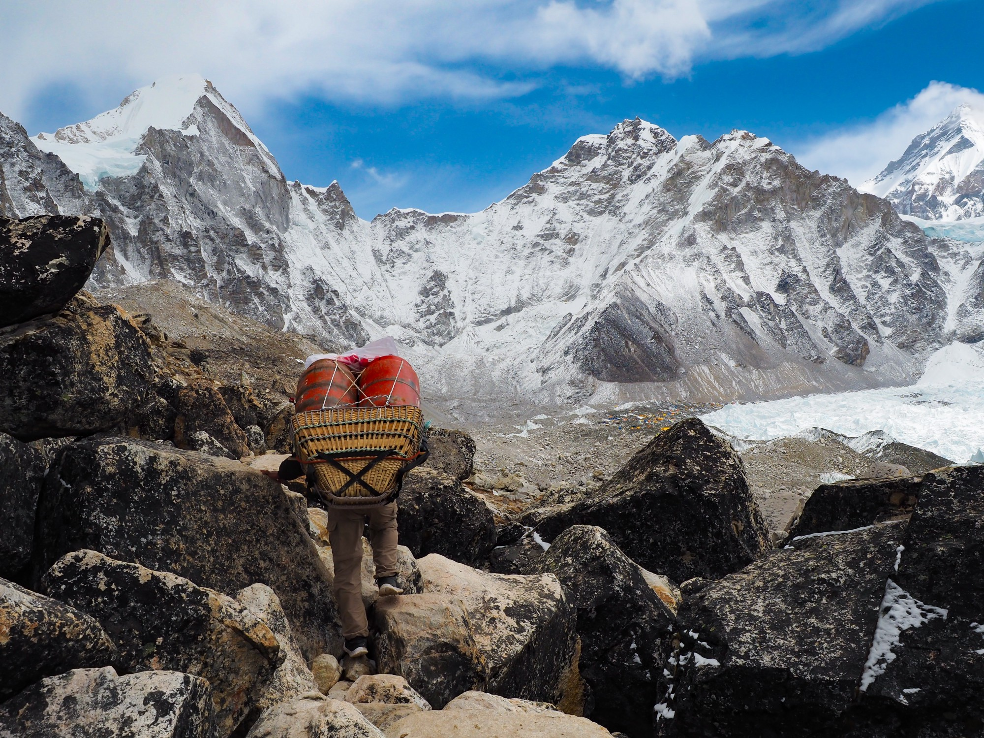A sherpa hauls supplies on the south side of the Everest Base Camp trek, at an altitude of 17,900 feet (5,500 m).
