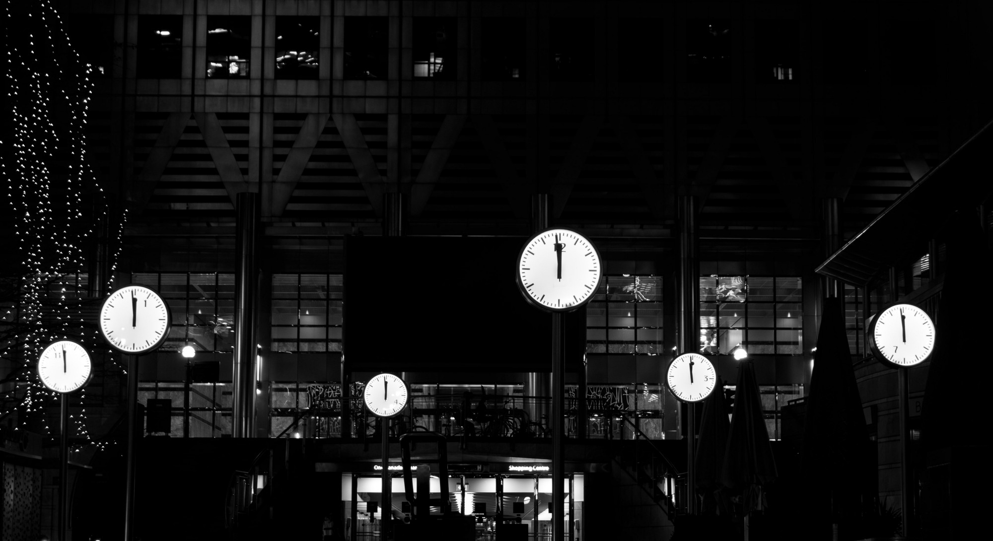 Several clocks in black and white.
