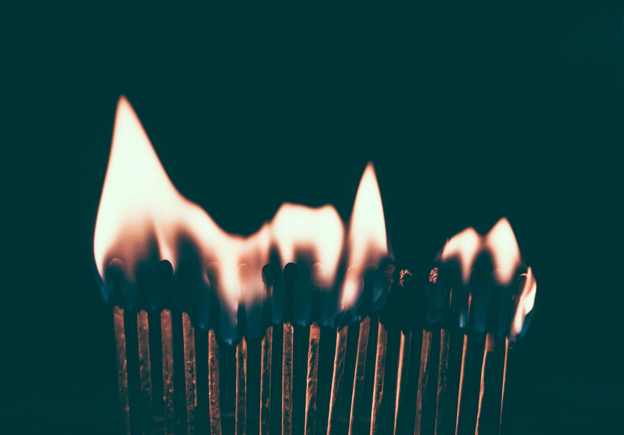 Matchsticks in a line, burning
