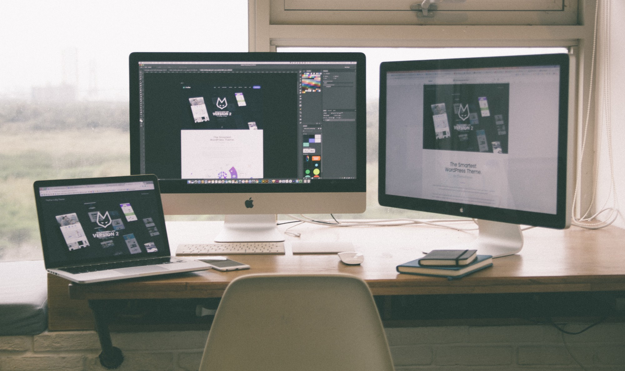 Modern desk with laptop and two monitors