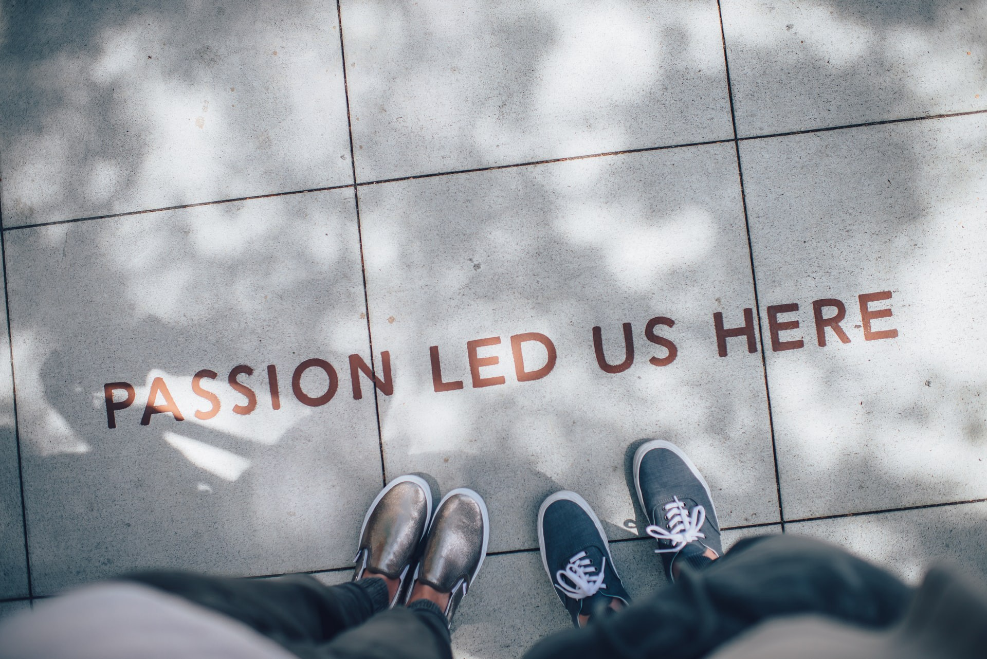 """Words on the pavement saying """"Passion led us here"""""""