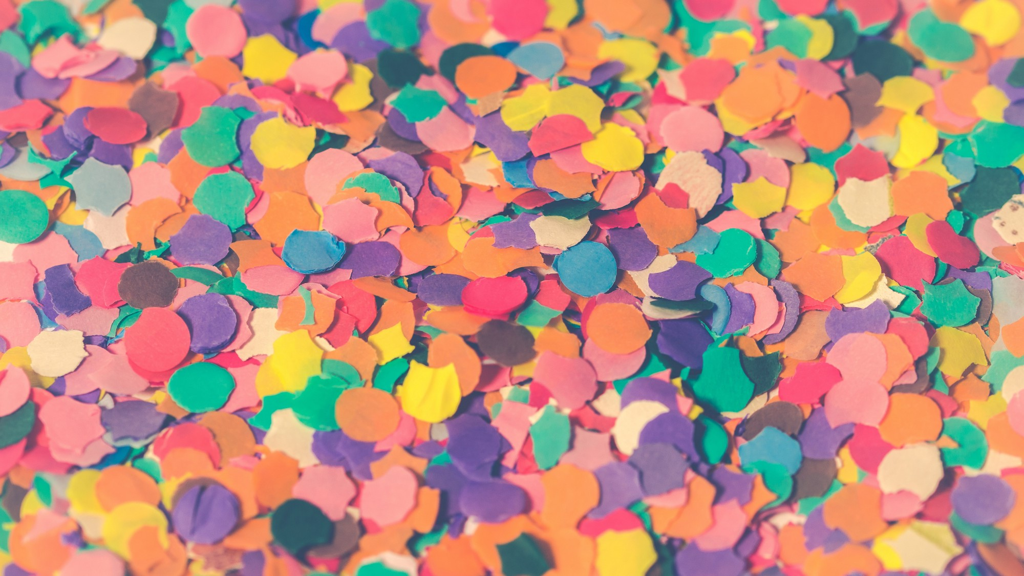 A pile of multi-colored paper confetti circles.