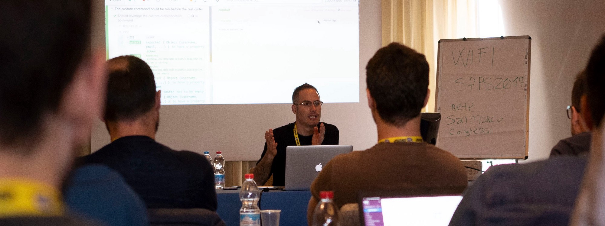 Me teaching at the Italian ReactJSDay conference. Thanks to Jaga Santagostino for the photo.