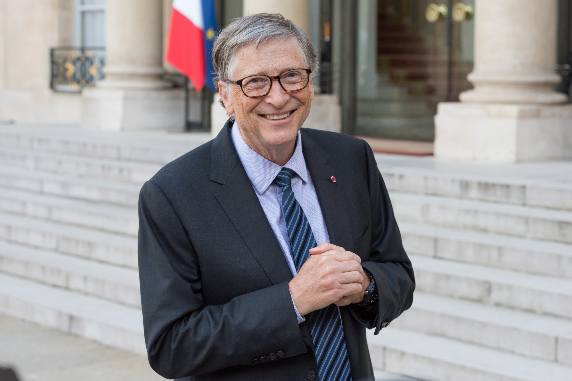 A photo of Bill Gates smiling.