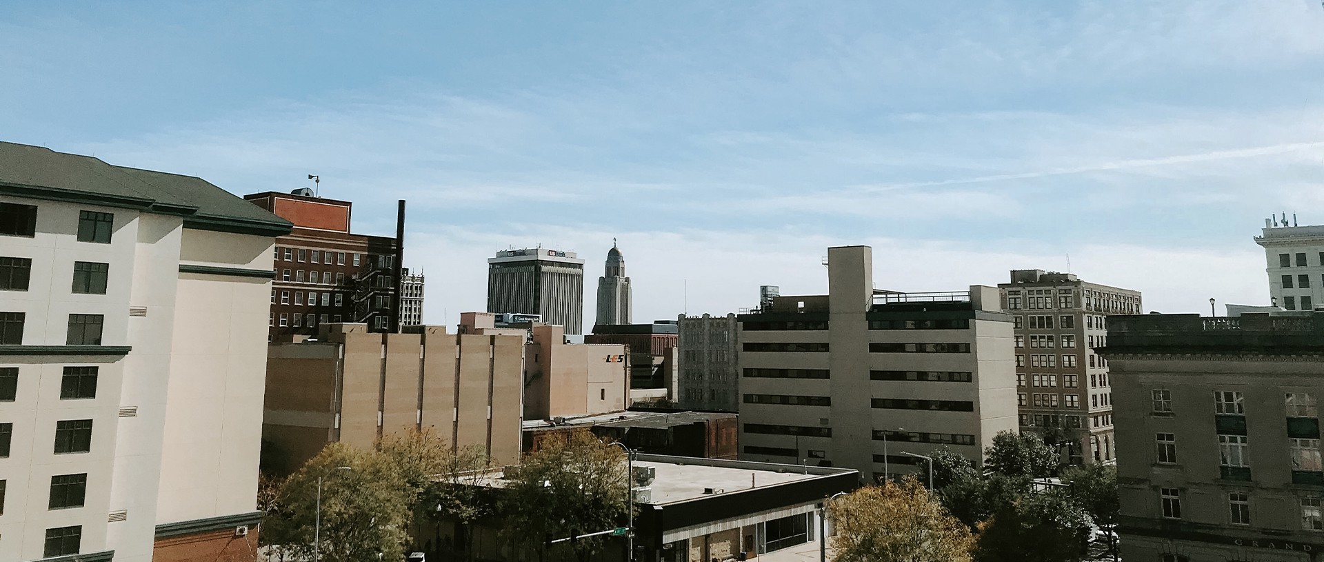 The Lincoln skyline with the state capitol in the distance on a sunny day