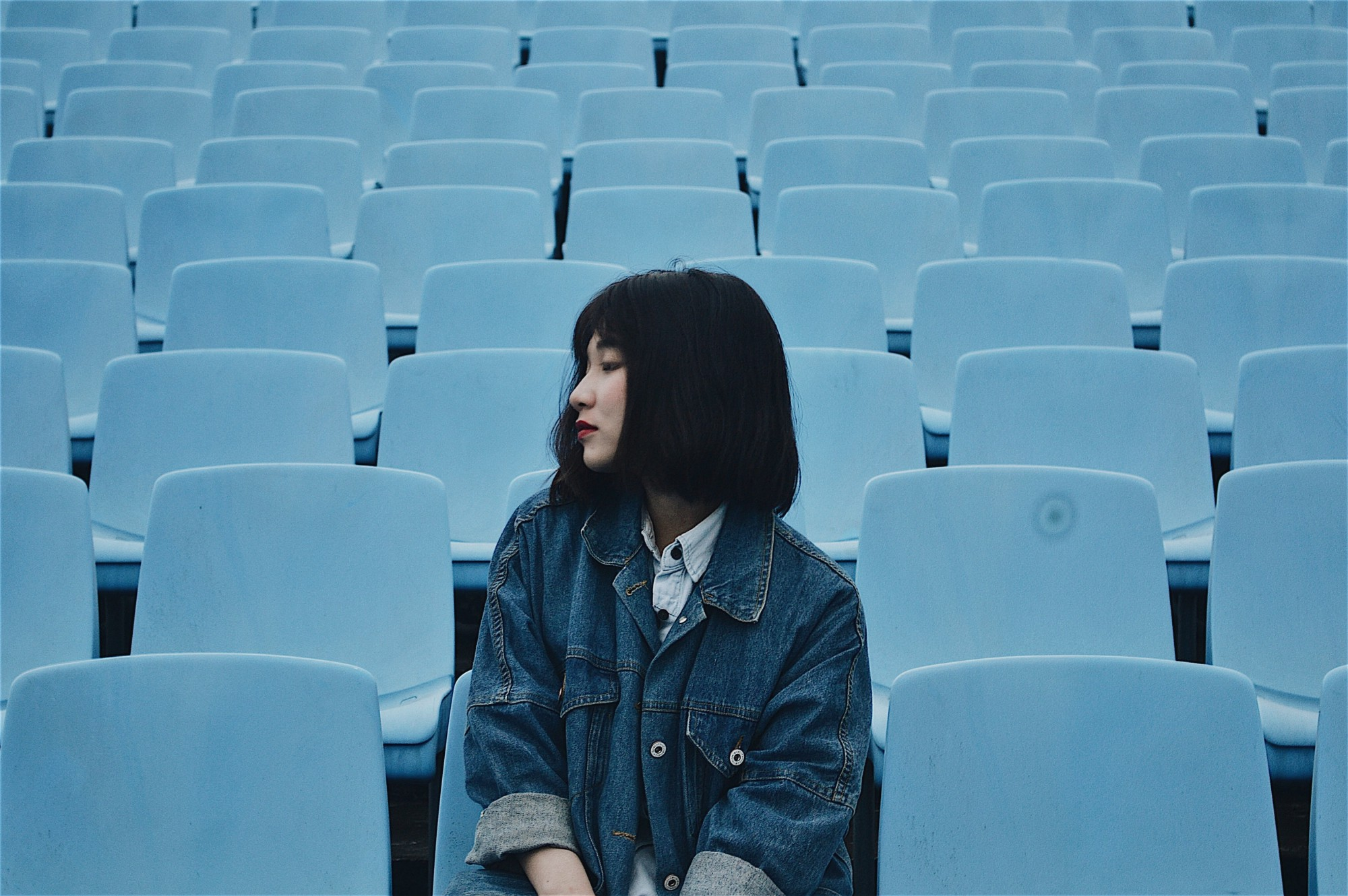How to Boost Your Self-Discipline Every Day—Asian girl sitting on spectator stands
