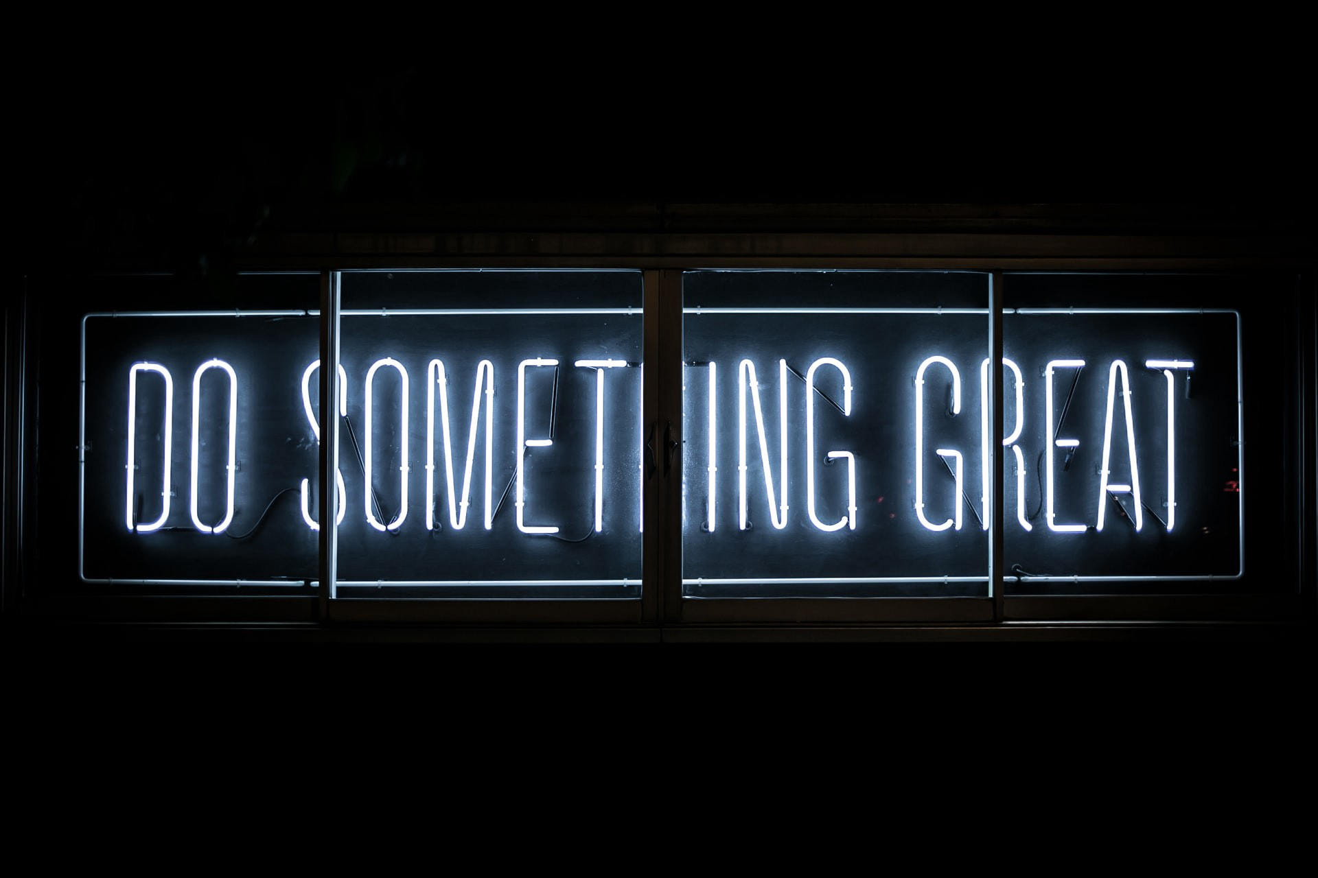 """Bright neon sign reading: """"DO SOMETHING GREAT"""""""
