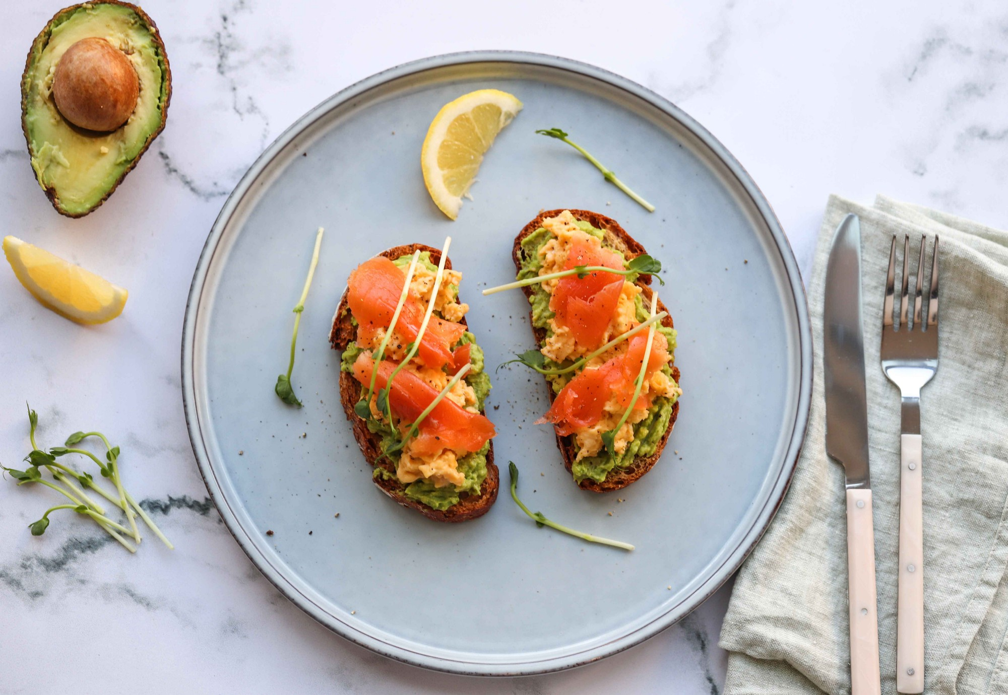 Avocado toast with eggs and salmon by FIT & NU™.