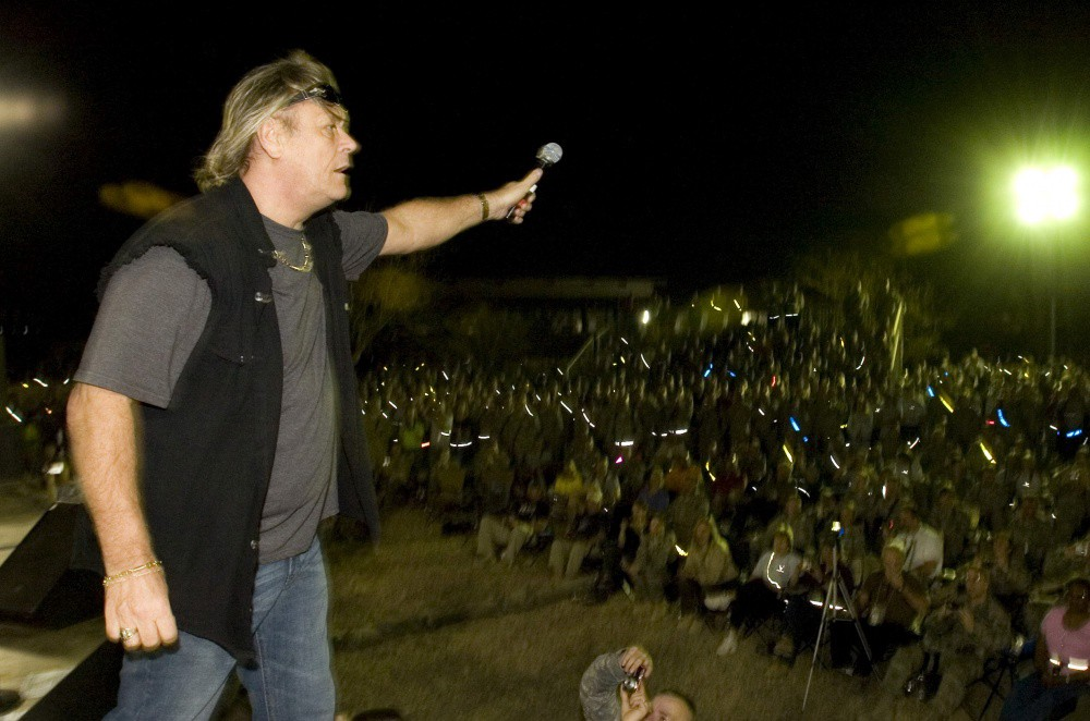 Brian Howe, former Bad Company Frontman gets the audience involved in the rock show (Baghdad, 2010, entertaining U.S. Troops)