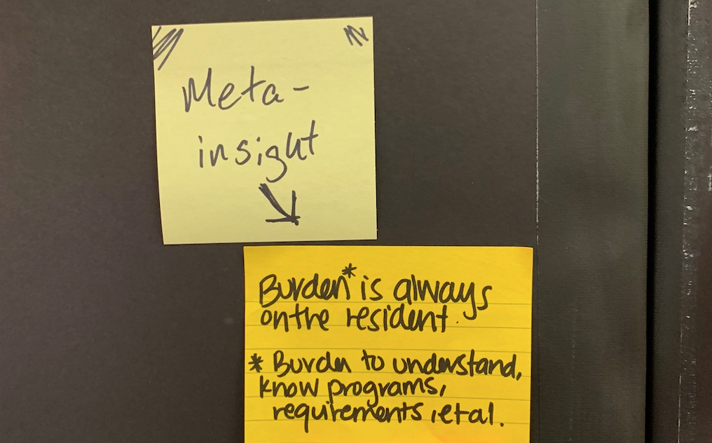 """Sticky note with the """"burden is always on the resident—burden to understand, know programs, requirements, et. """" text on it."""