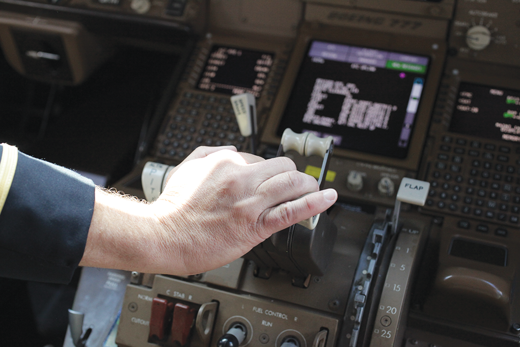 Photo of a hand on the throttle.