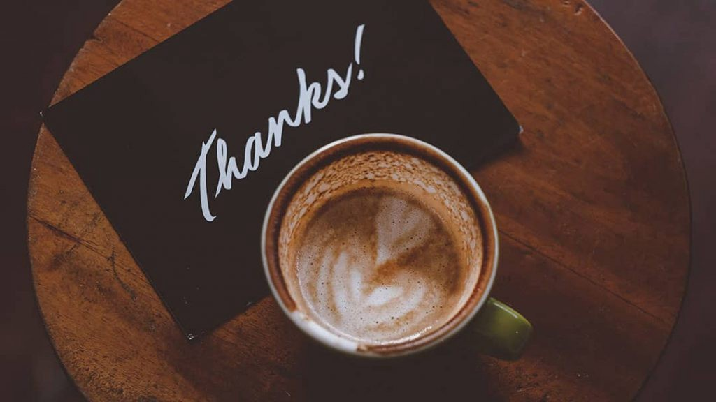 Coffee cup and thank you card