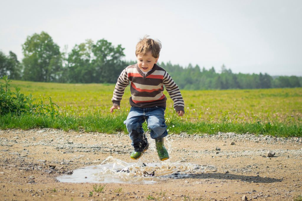 a kid playing outside