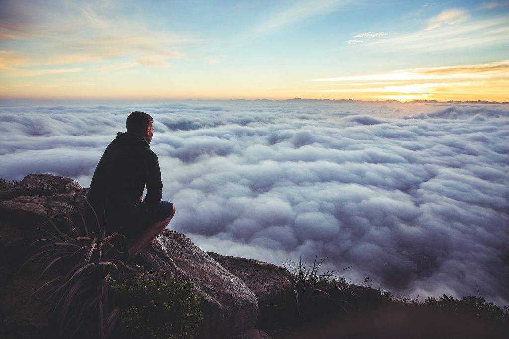 A person looking out to the clouds.