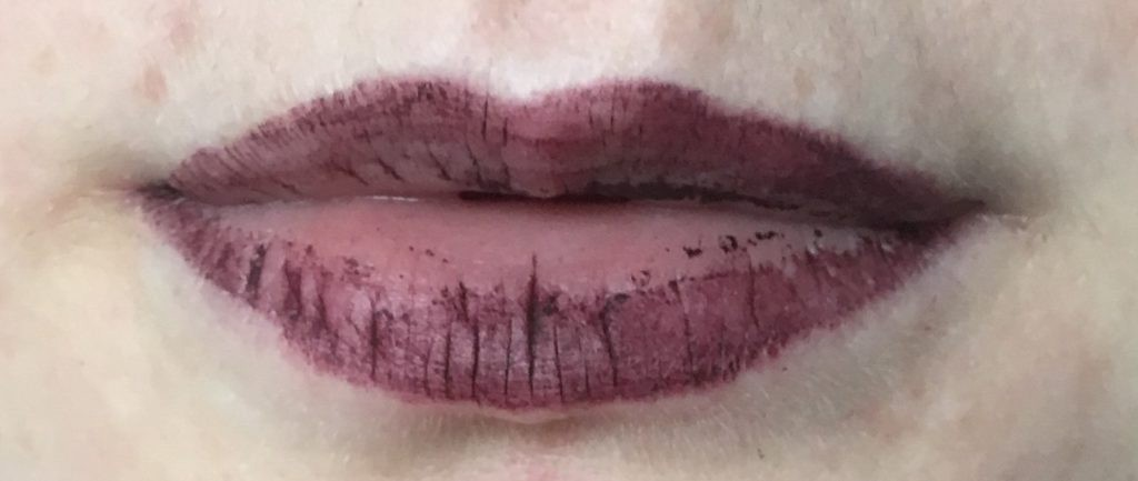 patchy half removed lipstick