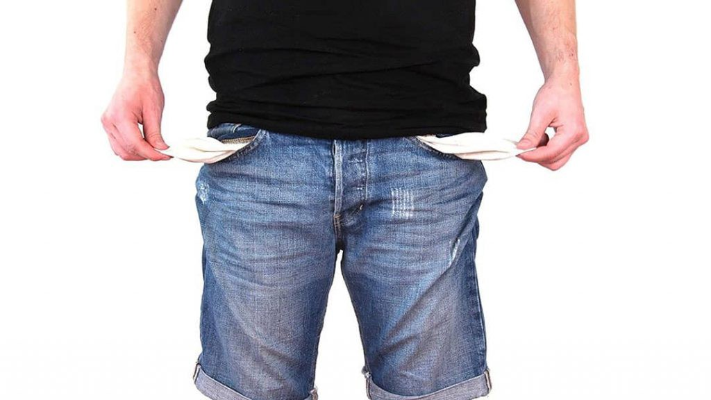 Small businessman turning his empty pockets inside out