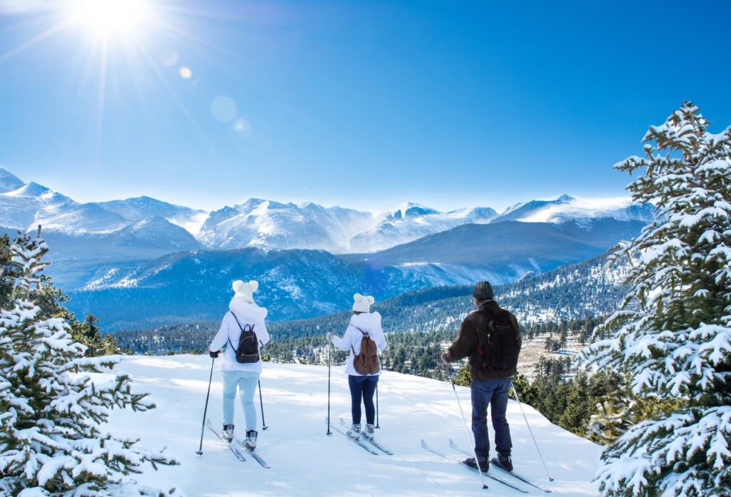 Active family skiing on winter vacation in Colorado