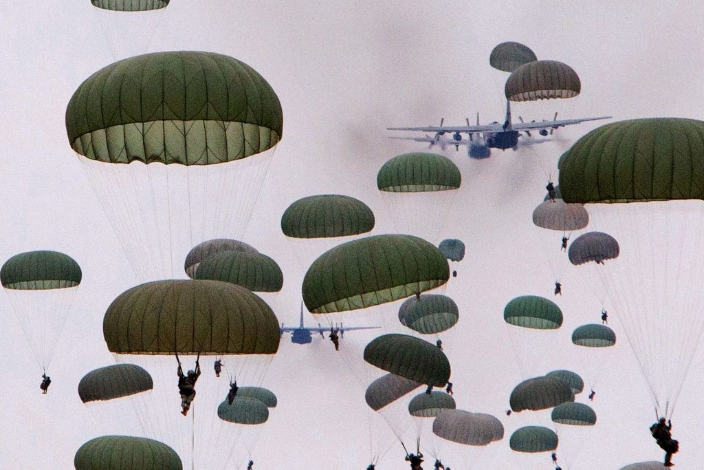 Paratroopers with the 82nd Airborne jump from C-130 Hercules aircraft during a mass-tactical airborne training exercise which included over a thousand paratroopers. (U.S. Army photo by Sgt. Michael J. MacLeod)