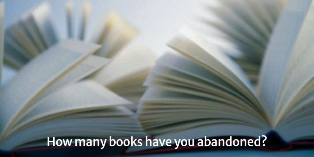 Open books with pages riffling on a white background. Question: How many books have you abandoned?
