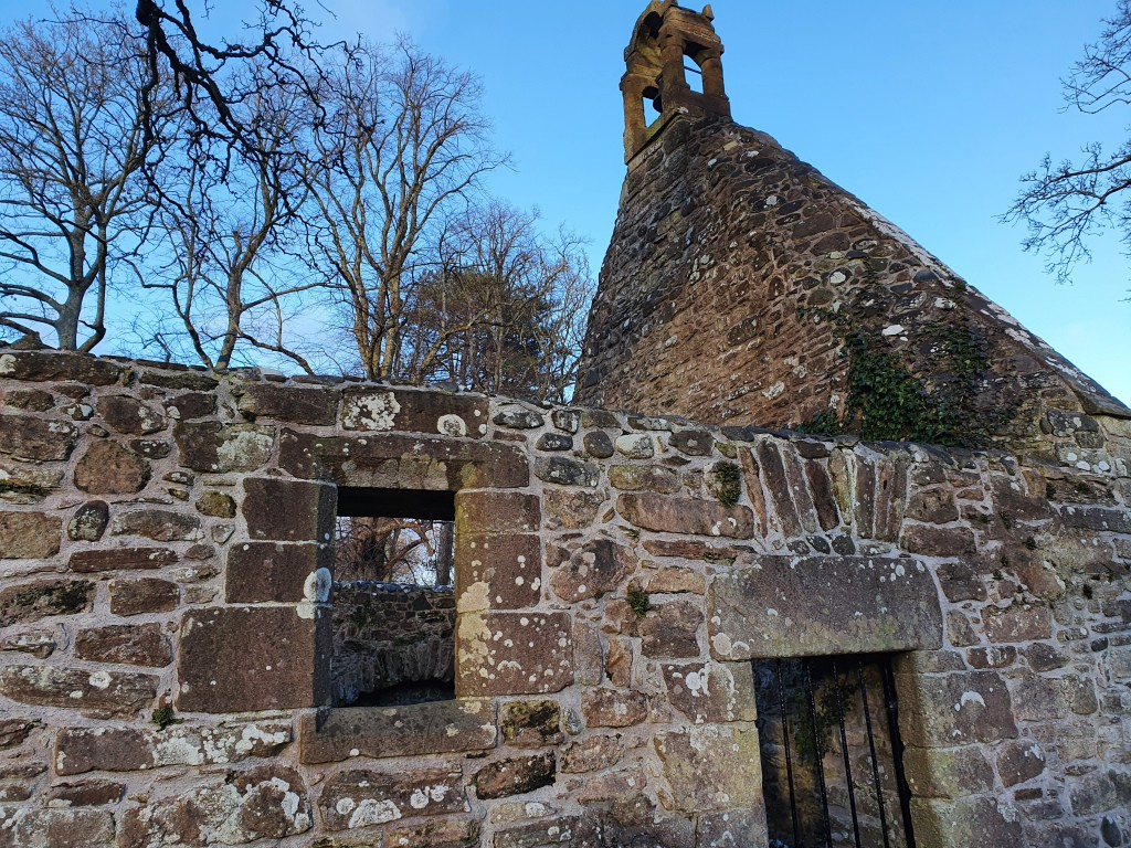 Picture of the auld kirk which features in the poem Tam O Shanter. A barred door and a window can be seen