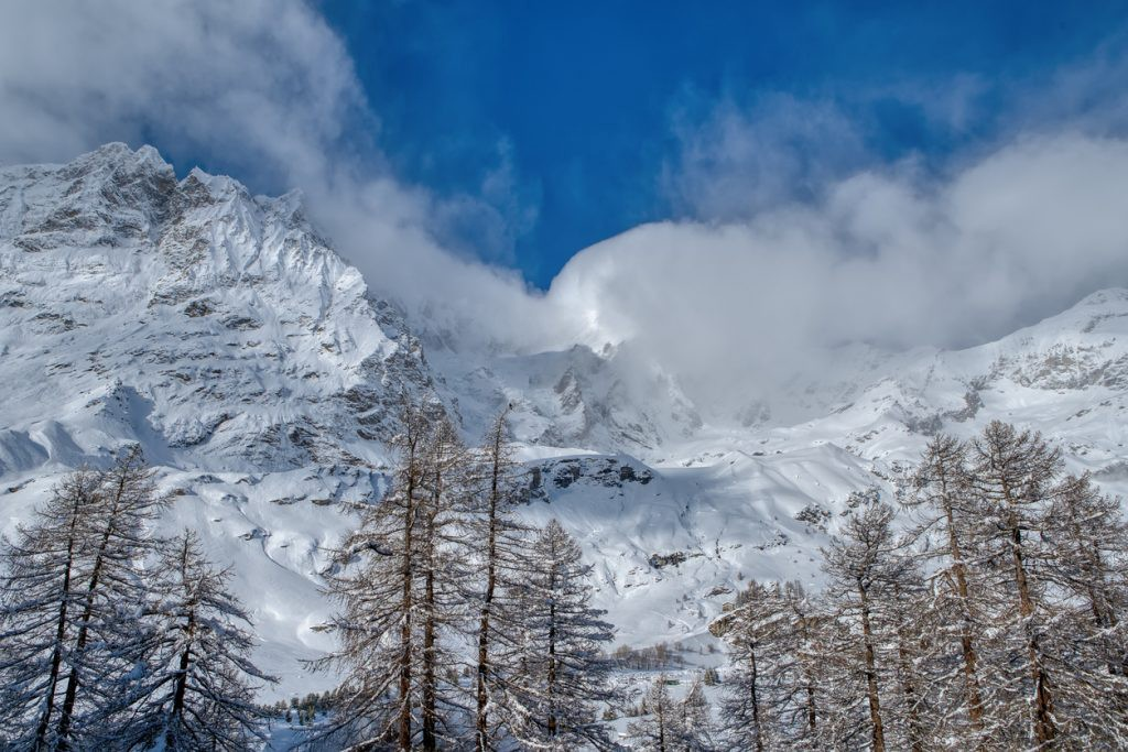 View Italian Alps and Matterhorn Peak under the clouds in December, Breuil-Cervinia
