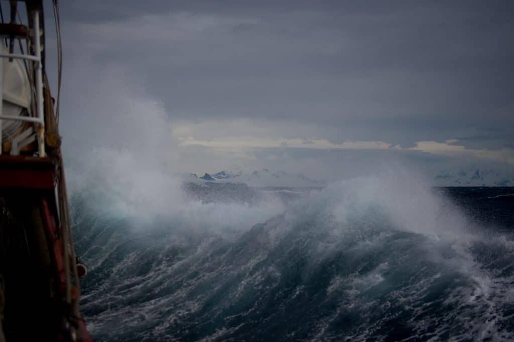 Business survival - picture of stormy sea taken from deck of ship, huge wave crashing around the vessel.