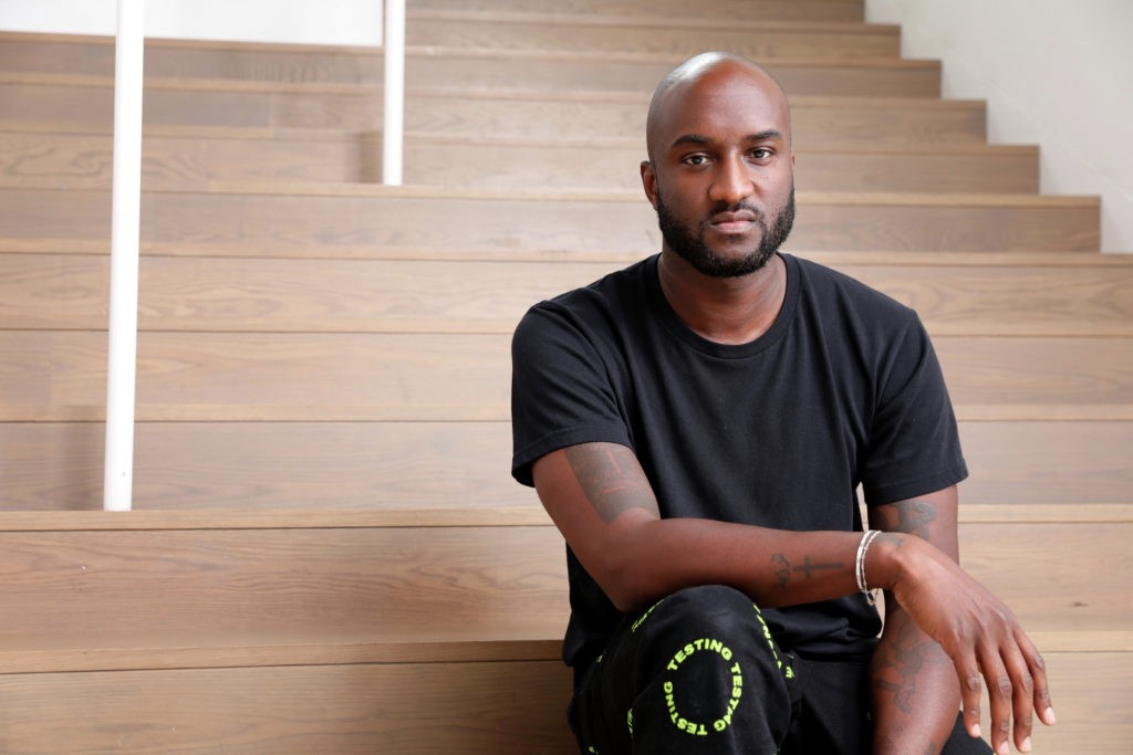 Virgil Abloh seated on a wide staircase.