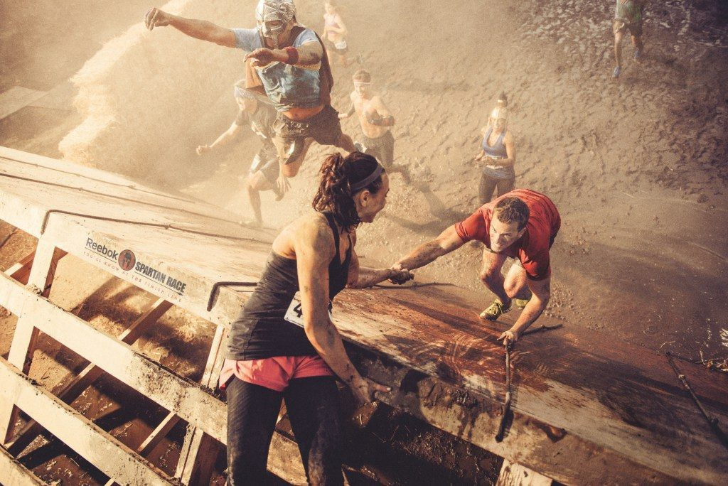 The All The Way Leader helps others move ahead. Photo credit - Reebok Spartan Race