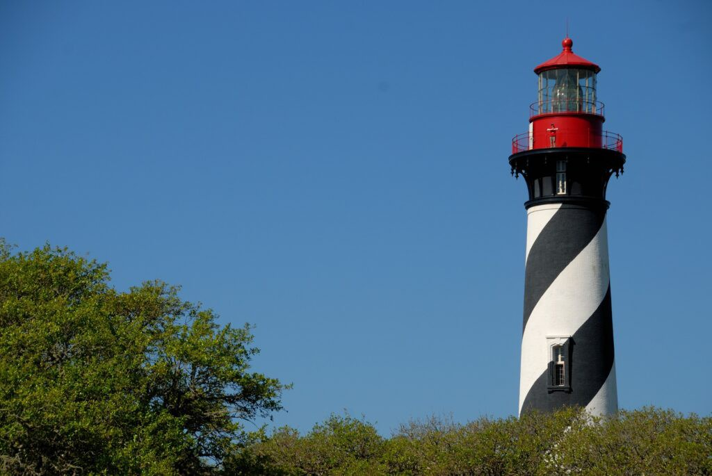 Lighthouse with red top and black/white stripes along the sides