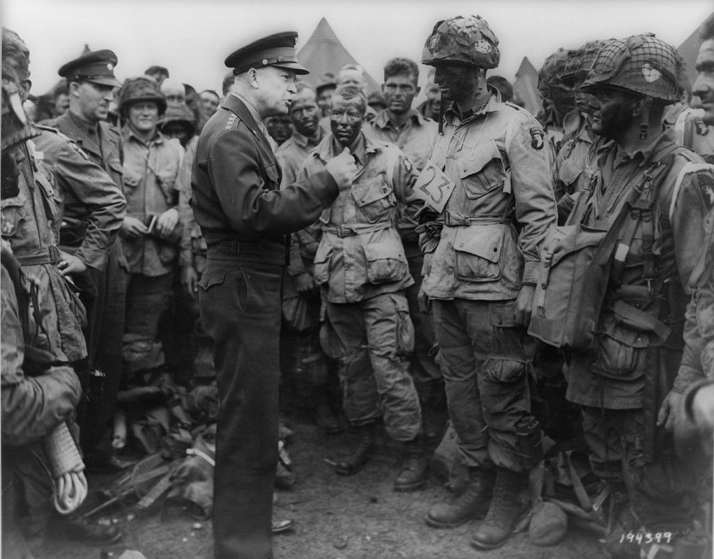 Famous photo of Eisenhower visiting paratroopers before D-day invasion.