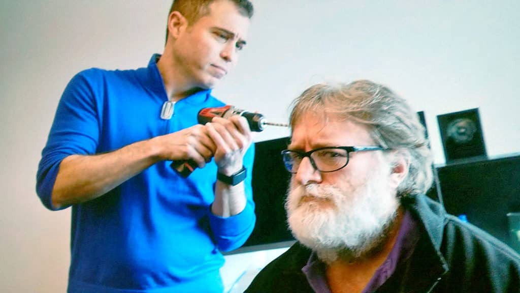 Mike Abinder pretending to drill into Gabe Newell's brain
