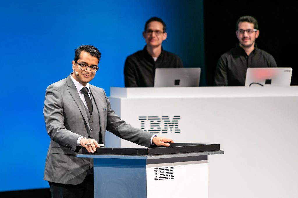 Harish Natarajan listening to Project Debater earlier this year at the IBM THINK conference in San Francisco.