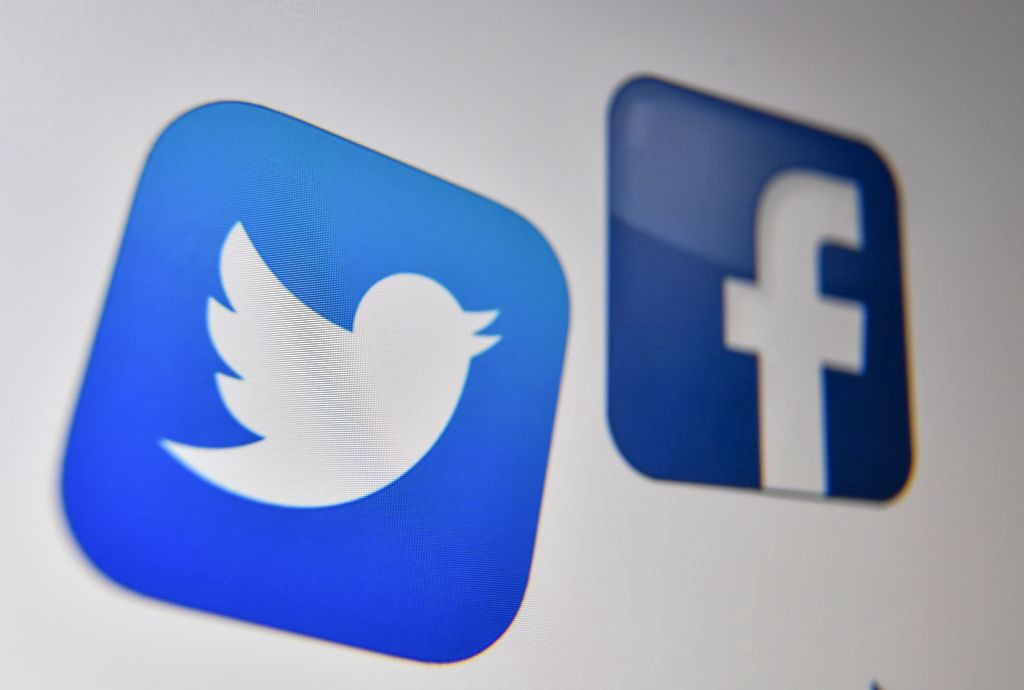 Twitter and Facebook logos.