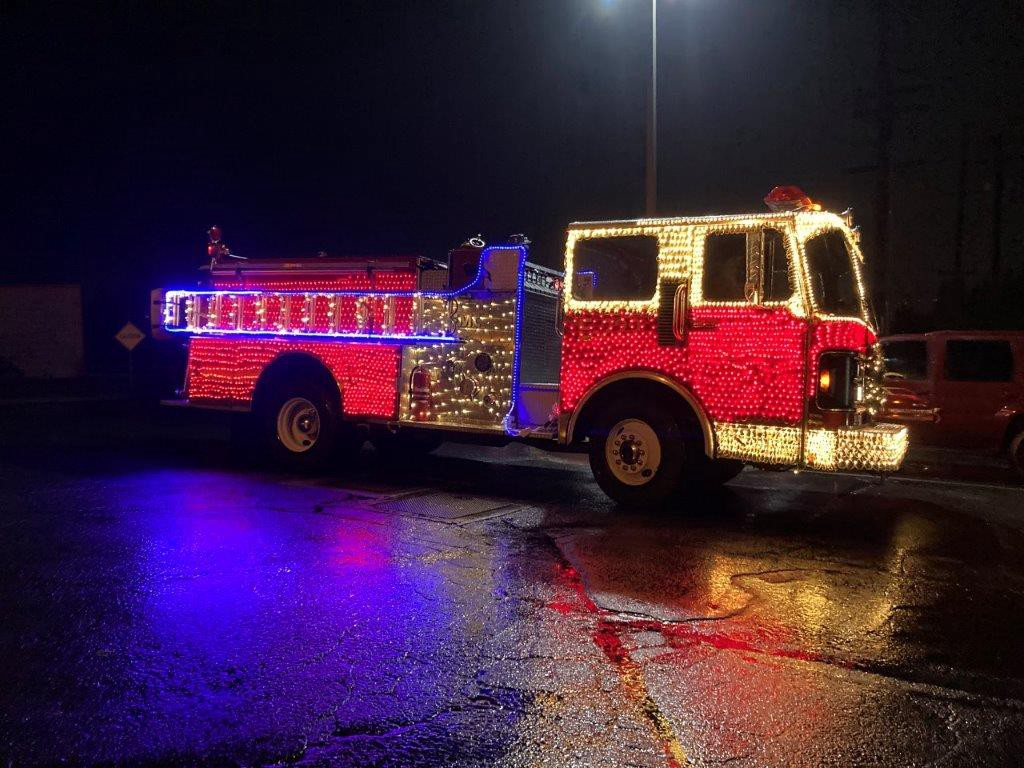 A lighted fire truck in the Yakima Valley School parade.