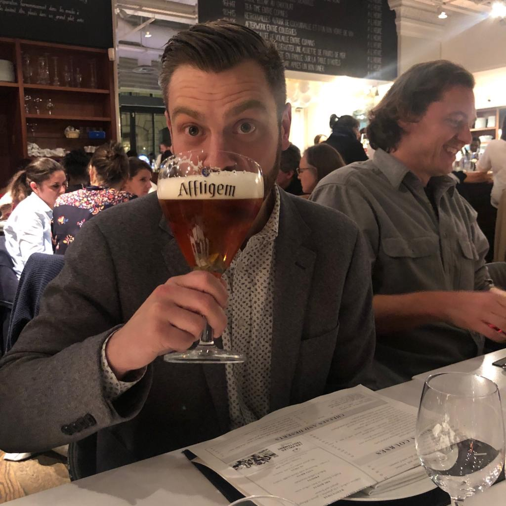 Gregory Harris sipping a humongous beer.