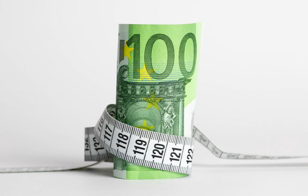 euro-banknote-with-measure-tape-on-white-background