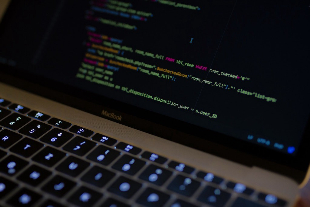 A macbook pro coding in CSS