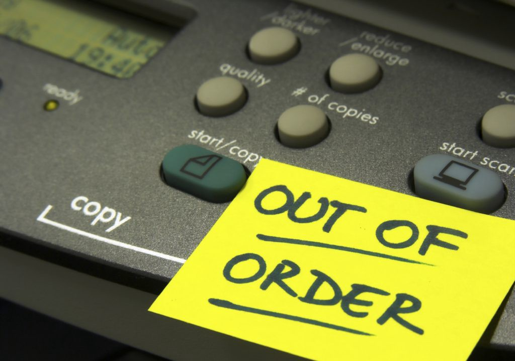 Out of Order sign on a printer