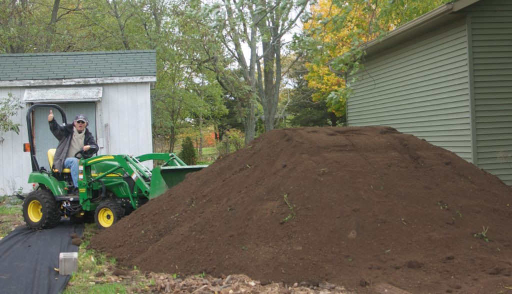 Two truckloads of field soil (no manure added) to make my garden.
