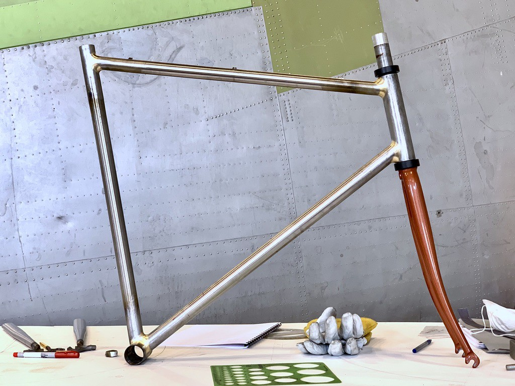 The front triangle of a bicycle frame resting on a bicycle fork
